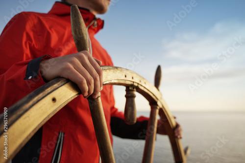 Canvas Captain Holding Hands on ship rudder