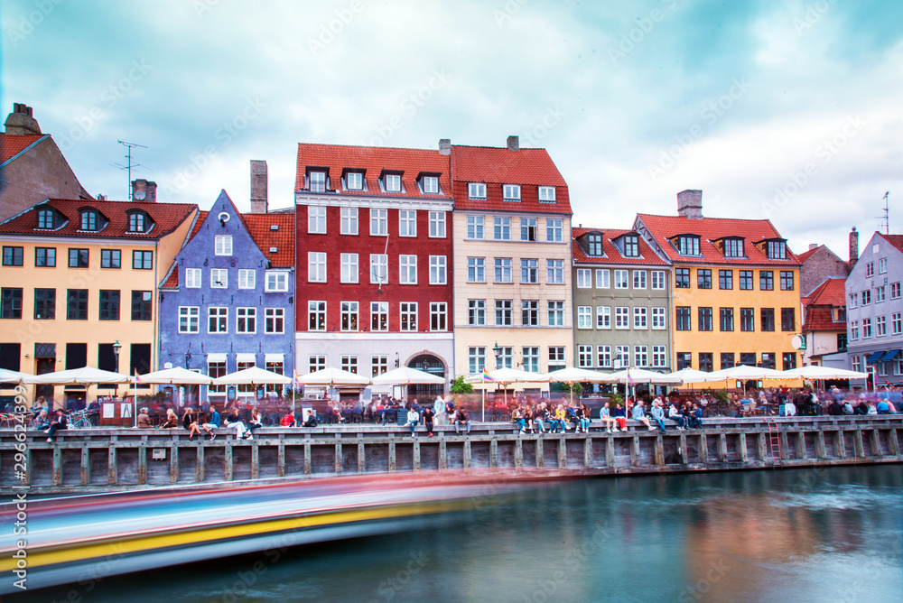 Breathtaking beautiful scenery with in the famous Nyhavn with strips from the trail of the sailing boat in Copenhagen, Denmark. Exotic amazing places. Popular tourist atraction. <span>plik: #296624399   autor: anko_ter</span>