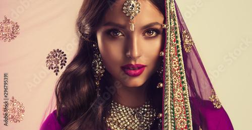Portrait of beautiful indian girl . Young hindu woman model  in sari and  kun...