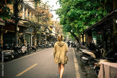 woman walking on the street in vietnam hanoi