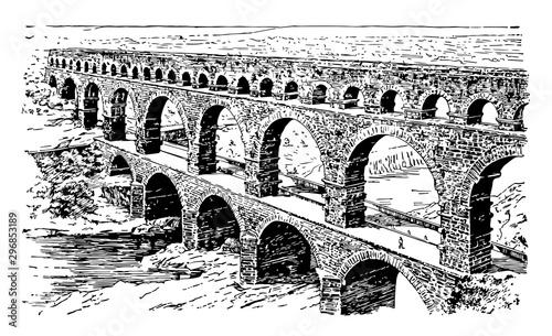 Fotografia A Roman Aqueduct ancient Nemausus vintage engraving.
