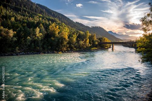 Fotografia, Obraz View over The Inn River In Hall in Tirol in Direction Innsbruck at sunset
