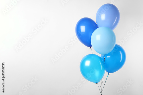 Leinwand Poster Bunch of blue balloons on white background. Greeting card
