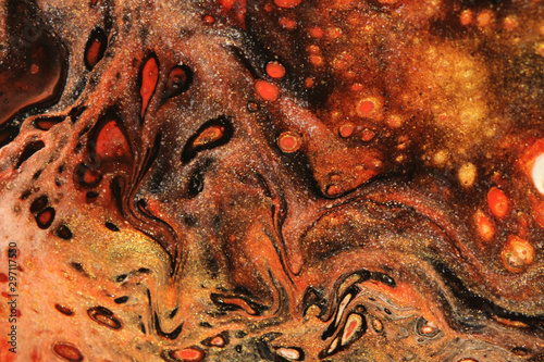 Obraz na plátně Black, red, and glittering gold coalesce to create this angry and anxiety filled abstract background