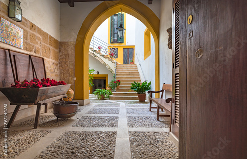 Canvas Print Majorca, Spain - January, 2019: Typical mediterranean patio courtyard in Palma d