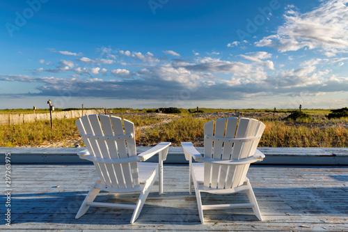 Slika na platnu Beach chair on Cape Cod beach at sunset, Cape Cod, Massachusetts, USA