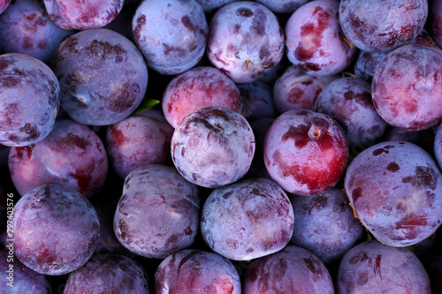 Wallpaper Mural fresh ripe plums as background