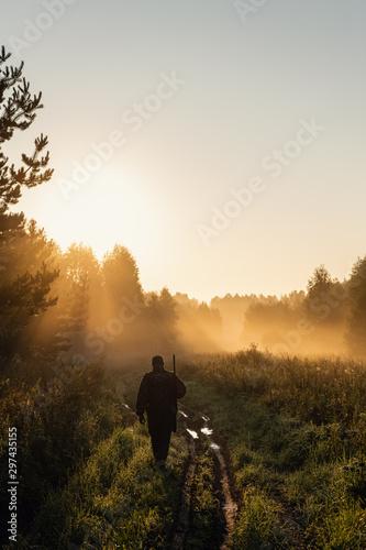 Fotografia, Obraz Vintage hunter walks the forest road