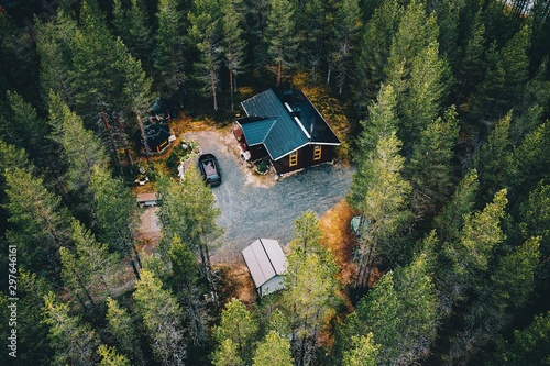 Aerial view of secluded cottage in the woods. Log cabin in the forest in rural Finland.