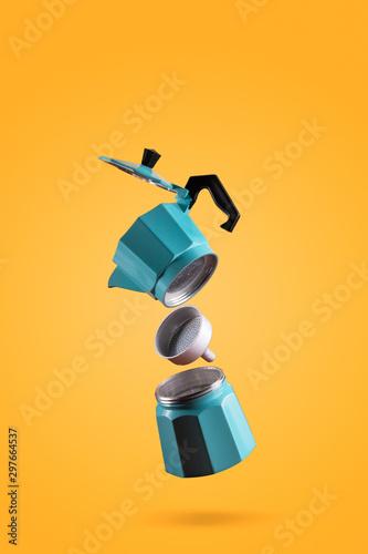 Parts of blue Italian retro coffee maker isolated on orange background Fototapete