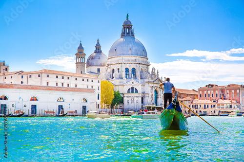 Fotografie, Tablou Gondolier and gondola on Grand Canal, Basilica Santa Maria della Salute in Venice, Italy