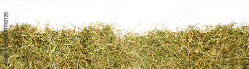 Valokuva a bunch of hay as banner, isolated with white background