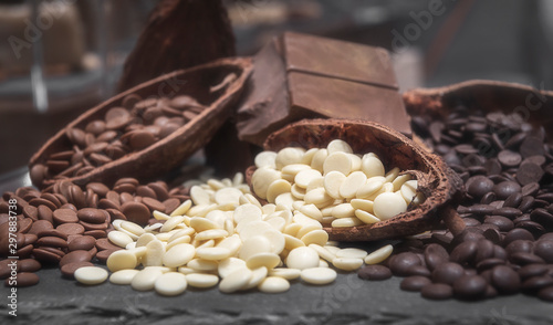 Fotografie, Obraz Variety of chocolate chips. White, milk and dark chocolate chips