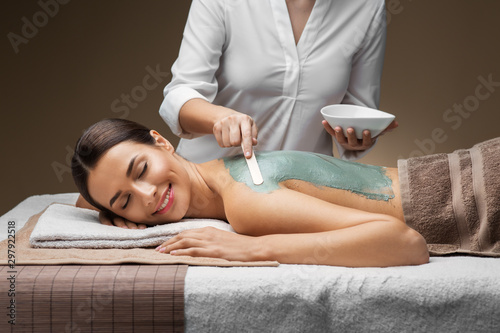 Carta da parati wellness, beauty and cosmetology concept - beautiful young woman lying with clos