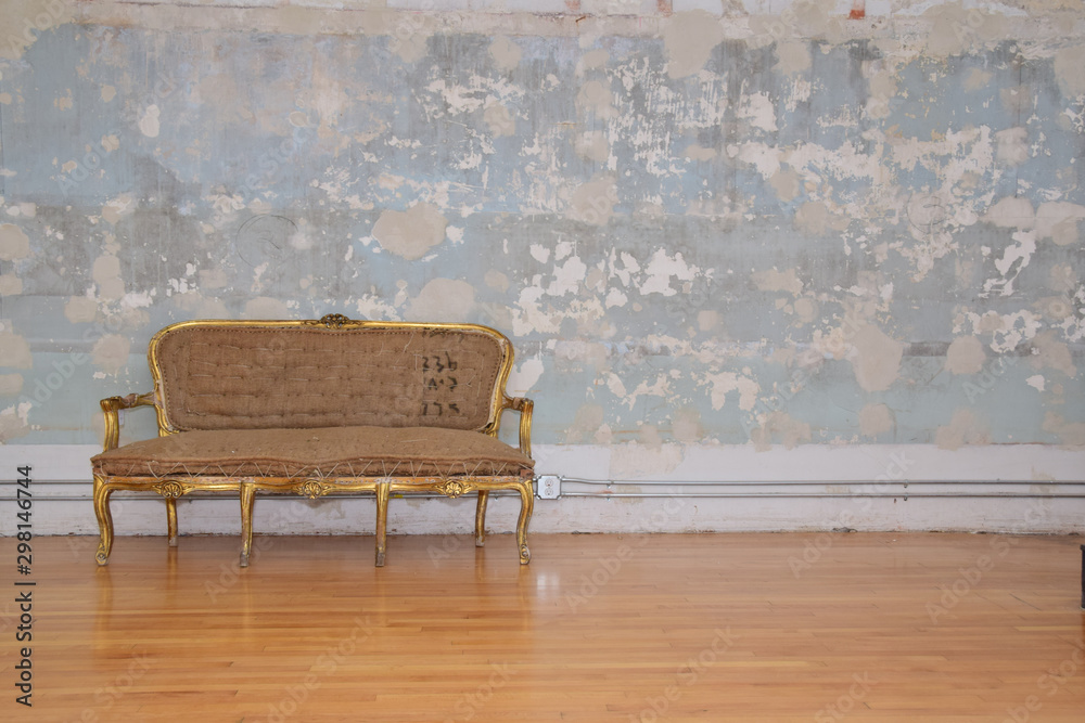 Couch against old wall
