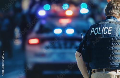 Photo Manhattan 2019. Behind the police with gun belt