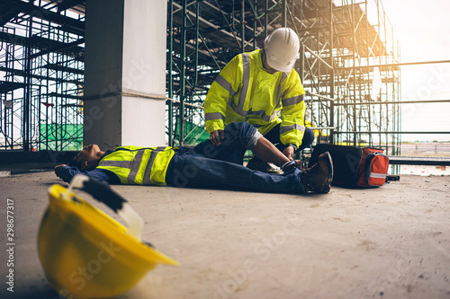 Fotografija First aid support accident in site work, Builder accident fall scaffolding to the floor, Safety team help employee accident