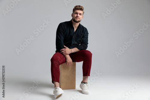 Canvas Print Tough fashion man seriously looking forward