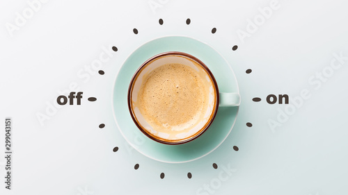 Valokuva Blue cup with cappuccino over grey background