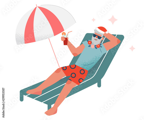 Fotografie, Tablou Bearded Man in Red Santa Hat Sitting on Sunbed and Drinking Cocktail on Beach, S