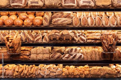 Bakery shelf with many types of bread Fototapeta