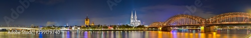 Panorama of cologne with the Hohenzollern Bridge over the Rhine River and Cologne Cathedral by night