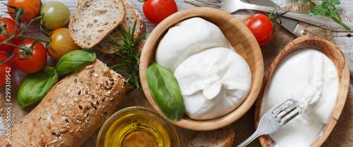 Fotografie, Obraz Italian cheese burrata with bread, vegetables and herbs