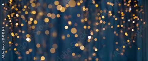 Fotografie, Tablou holiday illumination and decoration concept - christmas garland bokeh lights ove