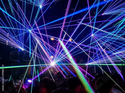 Obraz na plátně Colourful laser in a nightclub