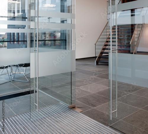 Modern architecture. Glass walls. Glass panels. Glass facade. Entrance office. Reception. Netherlands