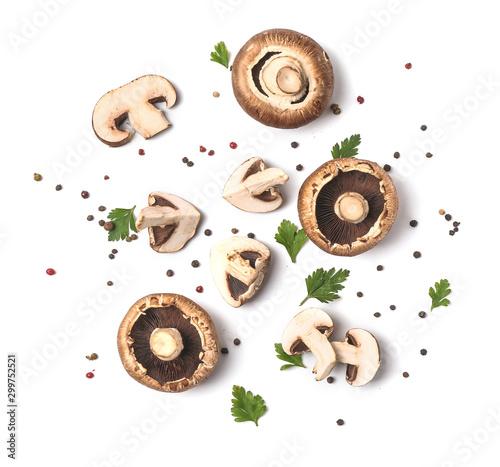 Obraz na płótnie Fresh champignon mushrooms, herbs and spices on white background