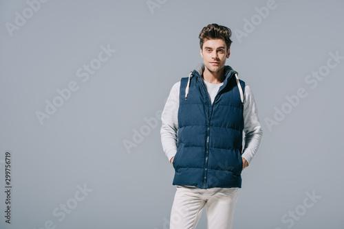 Fotografija handsome caucasian man posing in waistcoat, isolated on grey