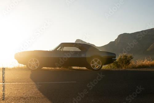Obraz na plátně Muscle car 1967 side view sunset