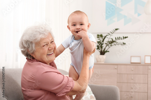 Fotografia, Obraz Happy grandmother with little baby at home