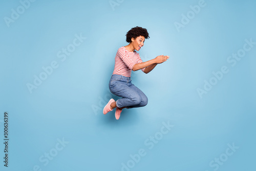 Stampa su Tela Full length profile side photo of excited cheerful afro american girl jump want