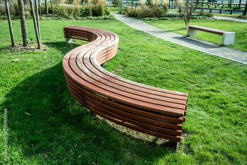 Obraz na płótnie A modern bench  in a city park on a sunny day