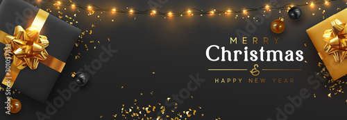 Wall mural Christmas banner. Background Xmas design of sparkling lights garland, realistic gifts box, black balls and glitter gold confetti. Horizontal christmas poster, greeting cards, headers website