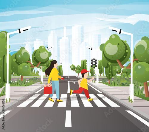 Foto Mom with Son Crossing Road On Crosswalk, Road Markings, Sidewalk for Pedestrians, Trees and Traffic Lights