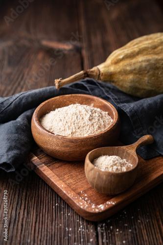 Fotografiet Organic baobab powder in a wooden bowl, healthy sport nutrition rich in vitamins