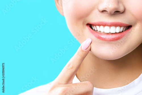 Wallpaper Mural Perfect healthy teeth smile of a young woman
