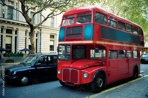 Wallpaper Mural Traditional red double-decker Routemaster bus, introduced in 1956, making its wa