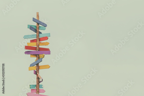 Canvas Print Retro styled image of colorful wooden direction arrow signs