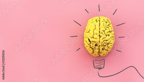Foto yellow brain on pink background