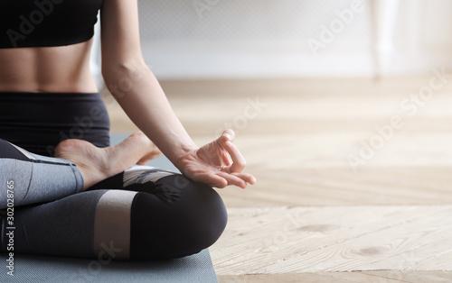 Close up of yoga woman sitting in lotus asana