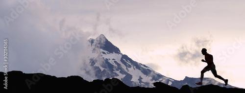 Fotografie, Obraz Running man athlete trail running in mountain summit background
