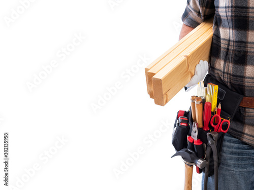Photographie Carpenter isolated on a white background; he wears leather work gloves, he is holding wooden boards