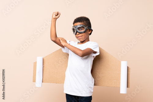 African American boy  with aviator hat and with wings and making strong gesture Fototapet