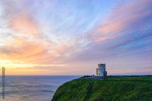 Wallpaper Mural Sunset at O'Brien Tower, Cliffs of Moher, County Clare, Ireland