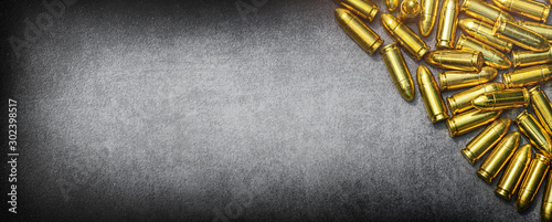 Fotografija Bullets ammunition on stone table wide banner or panorama