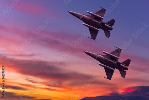 Canvas Print Army Show performant of air craft in air show with twilight sky background